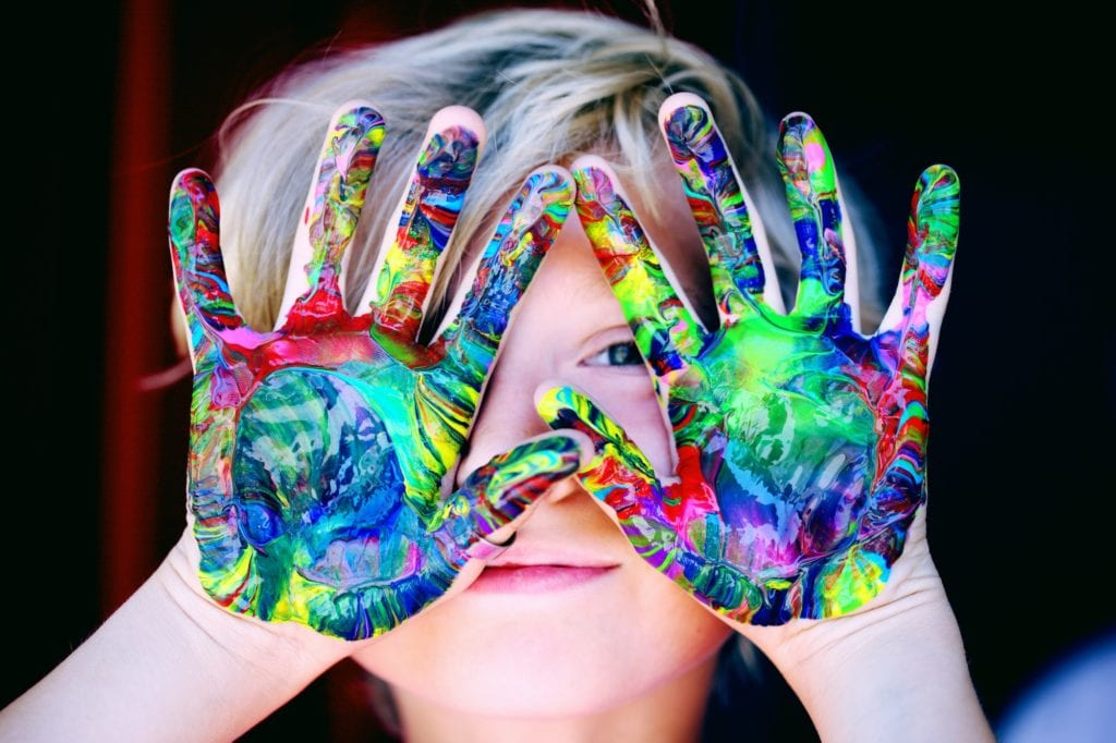 Photo of a child playing with finger paints