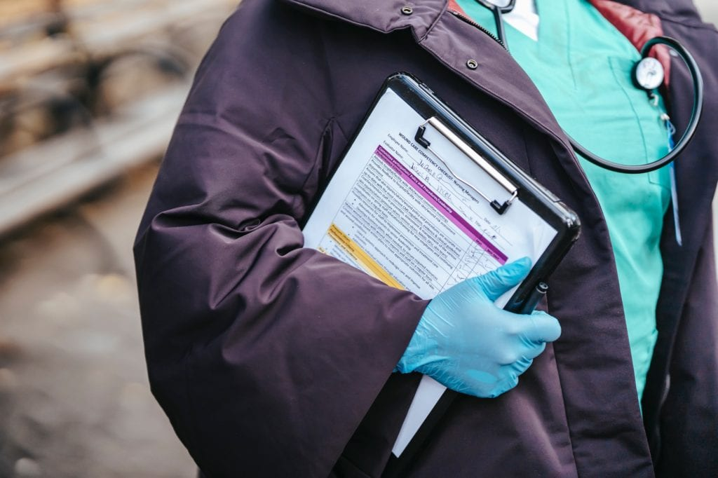 Photo of a nurse holding a clipboard